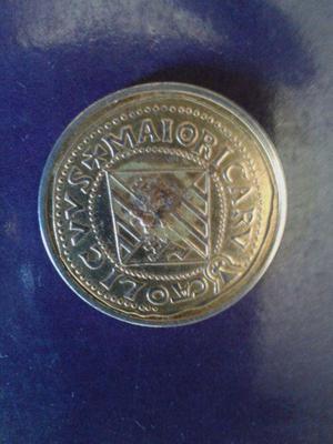 Monedas antiguas de 100 años
