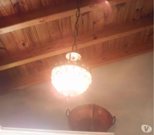 Vendo lampara colgante.diseñada con piedras y bronce