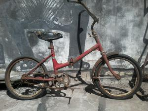 Bicicleta antigua plegable multiuso