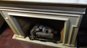 estufa a gas con leños