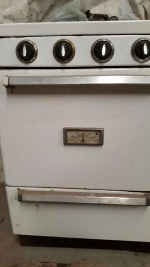 cocina de tres hornallas funcionado para gas de red mas