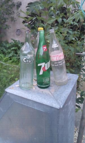 Vendo 4 botellas de 1 litro antiguas