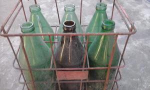 botellas grandes con canasto antiguo vendo o permuto