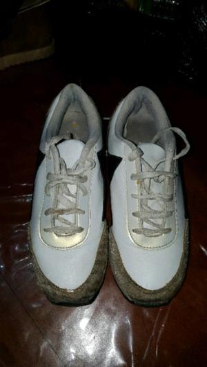 Zapatillas con detalles de piel