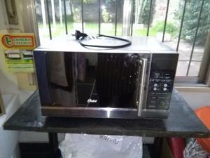 Microondas Oster 25litros, con grill 900W.
