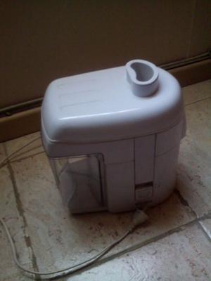 extractor de jugo casi sin uso
