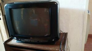 Vendo televisor con mesa