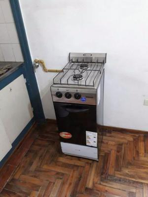 Cocina gas natural, 2 hornallas y horno. Sin uso