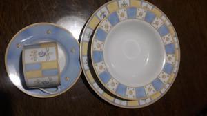 Juego de platos en porcelana.Nuevo