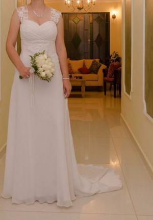Vendo vestido de novia. Impecable. Un solo uso.