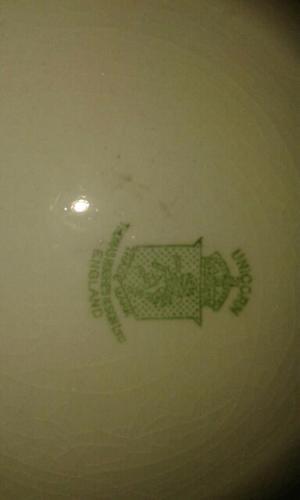 Platos porcelana importados mas juego de tetera y platos