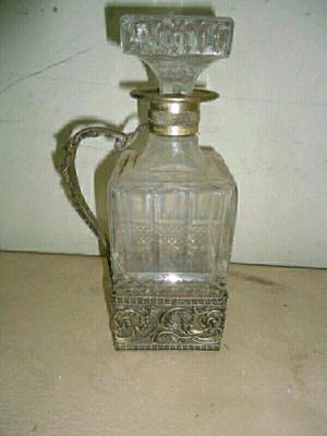 Botella antigua de cristal y plata