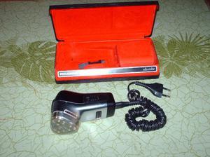 una maquina de afeitar electrica (marca fhilips ajustable