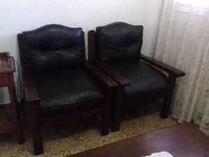 Juego de sillones en algarrobo con almohadones en cuero