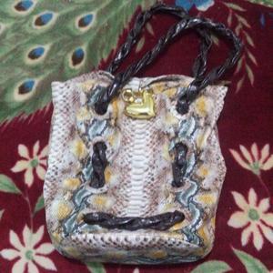 Vendo bolso de cuero nuevo a 400 pesos