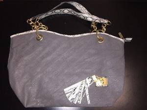 Vendo cartera gris