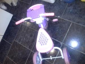 Vendo triciclo color rosa