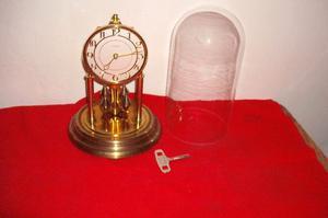Reloj antiguo péndulo de torsión con cúpula original de