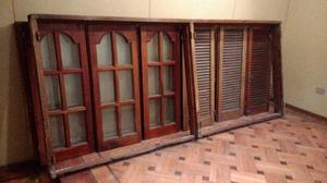 Ventanas de cedro barnizado con herajes de bronce