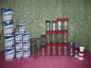 Frascos de vidrio potes de crema y latas de aluminio