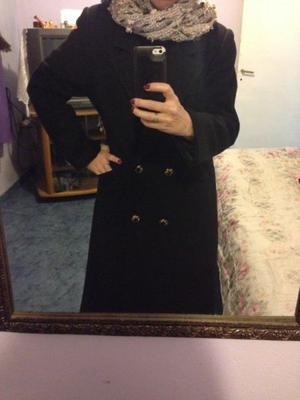 Tapado Negro con dos bolsillos, bien abrigado. se puede