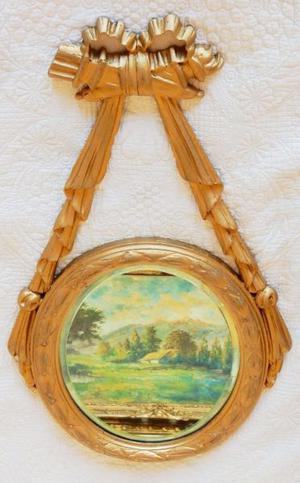 Espejo Oval biselado muy Antiguo con marco de madera dorado