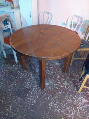 mesa redonda extensible con 4 sillas