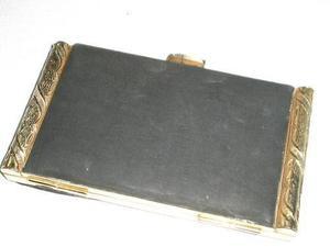 neceser- polvera dorado y seda negra perfecta sin uso$