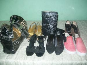 Lote de zapatos y cartera.-
