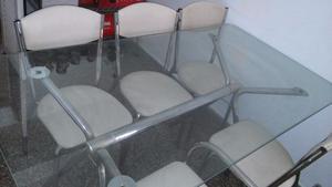 Vendo juego de mesa de vidrio con 6 sillas cromadas 1,50 x