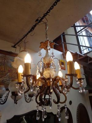 Antigua araña de bronce y vidrio, caireles. Antigua Saudade