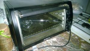 vendo horno electrico de color negro impecable