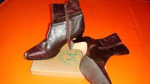 botas de cuero y zueco cuero