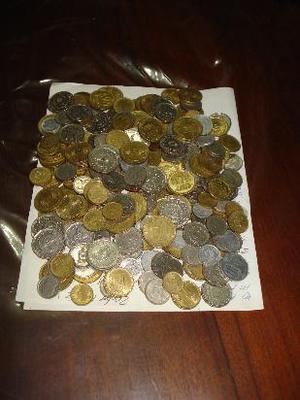 1 kg de monedas argentinas desde  a  aproximadamente