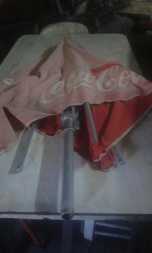 Sombrilla de tela de coca cola.