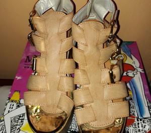 Vendo sandalias de plataformas marrones. Número 39