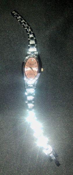 Reloj pulsera y Brazalete de acero quirúrgico