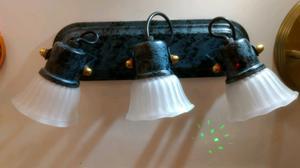 Aplique oval de tres luces