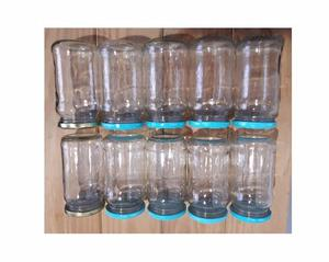 10 frascos de vidrio con tapas. De mermelada vacíos.