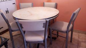 Mesa redonda y seis sillas nuevas casi sin uso