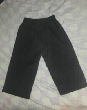 Pantalon negro de vestir con botón cierre y elastico talle