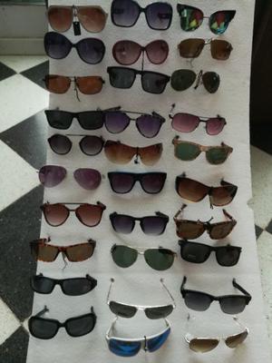 Liquido 33 lentes de sol nuevos
