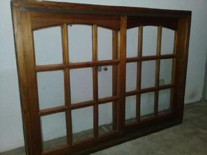Ventana de madera corrediza con vidrio repartido