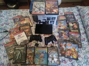 Playstation 2 Slim, 2 Joysticks, Volante y 4 Juegos