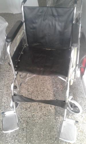 Silla de rueda nueva cromada.