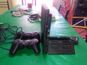 PlayStation 2.vendo con 2 joystick y accesorio para 4