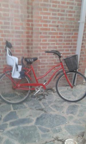bicicleta de mujer con asiento de bebés