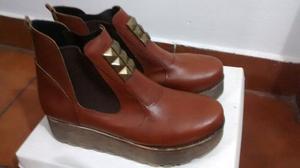 Vendo botas color suela nro 39, nuevas