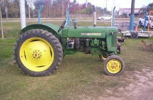 Tractor John Deere 445 con cortadora de pasto en muy buen