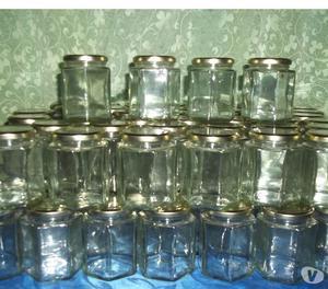 Frascos de vidrio hexagonales y redondos